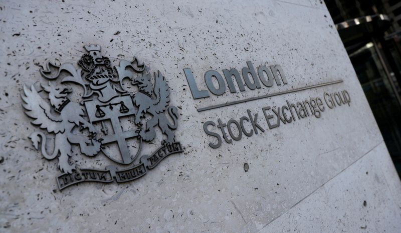 © Reuters. FILE PHOTO: Signage is seen outside the entrance of the London Stock Exchange in London