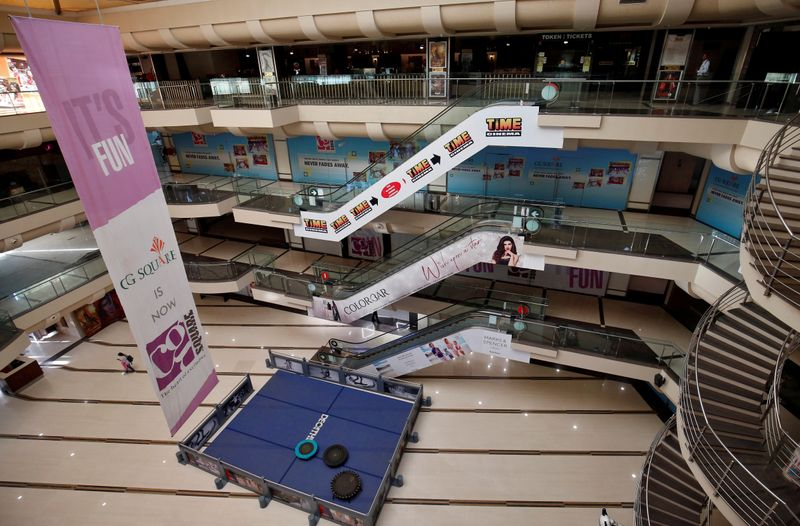 © Reuters. FILE PHOTO: A view of an empty shopping mall is seen after Gujarat state government banned public gatherings to avoid the spreading of the coronavirus, in Ahmedabad