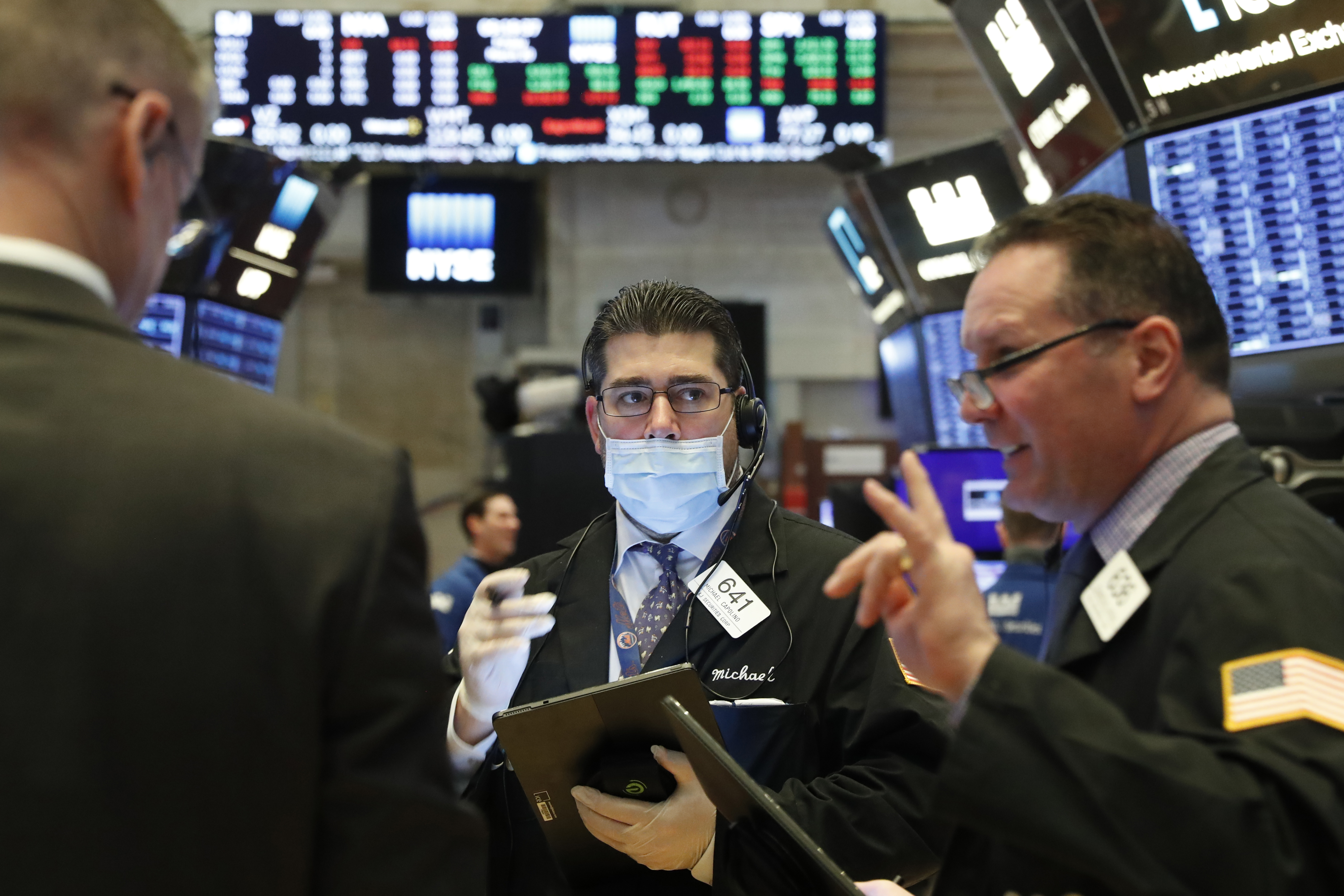Wall Street slumps after three-day rally as virus threat intensifies