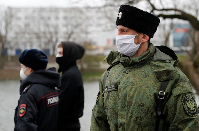 © Reuters. Cossacks wear SilverMask reusable face masks as they patrol the streets in Kaliningrad