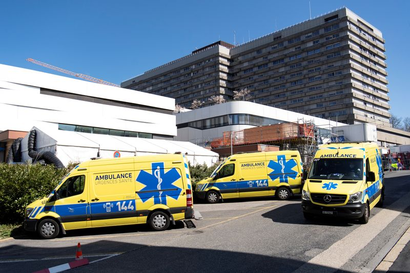 © Reuters. FILE PHOTO: Ambulances are pictured in front of a temporary space for patients at the CHUV in Lausanne