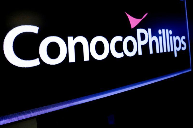 ConocoPhillips swings to loss on oil price slump, impairments