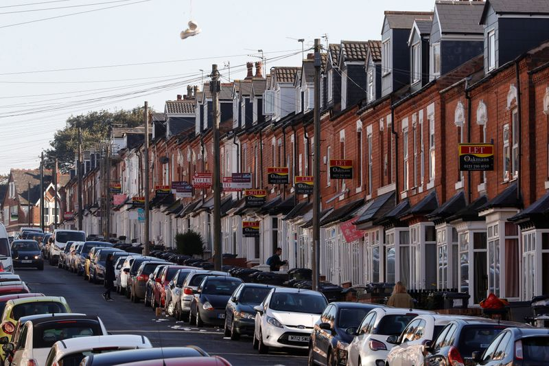© Reuters. Estate agent's signs hang from houses in the Selly Oak area of Birmingham