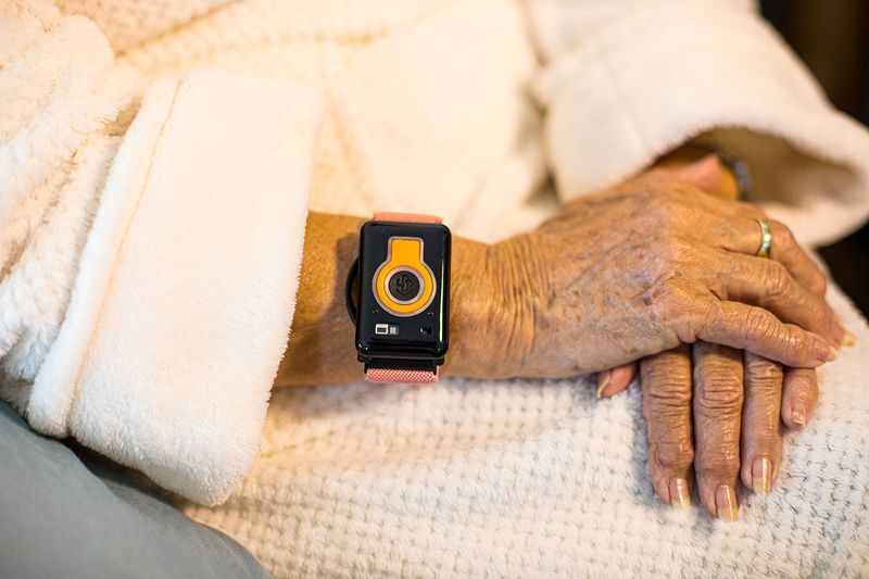© Reuters. A photo illustration provided by CarePredict shows an individual wearing the company's Tempo wearable wristband