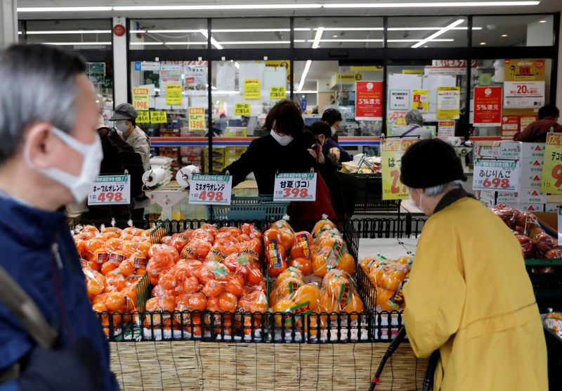 Japan's core consumer prices slip into deflation for first time in three years