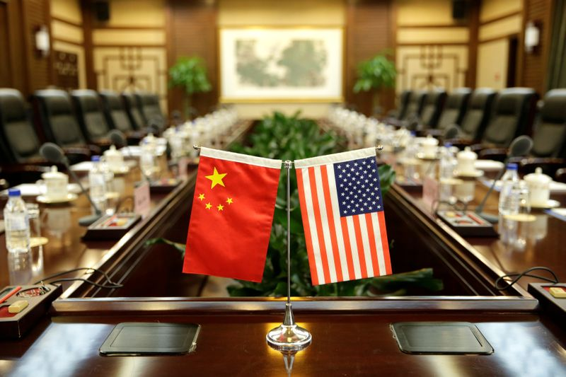 © Reuters. Flags of U.S. and China are placed for a meeting between Secretary of Agriculture Sonny Perdue and China's Minister of Agriculture Han Changfu in Beijing