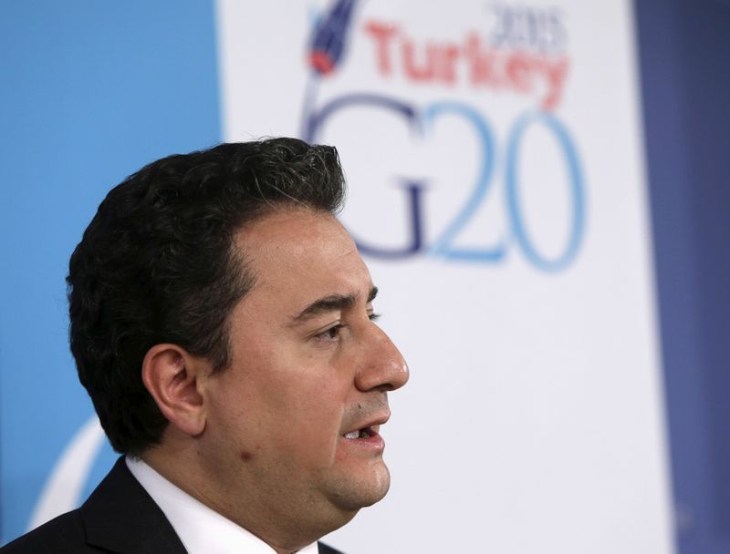 © Reuters. FILE PHOTO: Turkey's Deputy Prime Minister for the Economy Babacan answers question at a news conference during IMF spring meetings in Washington