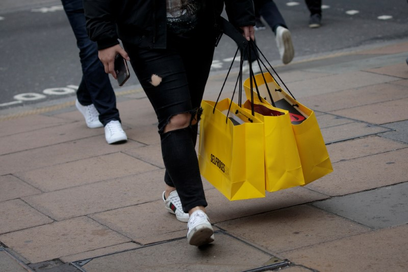 UK shoppers start to spend again, but public borrowing hits record