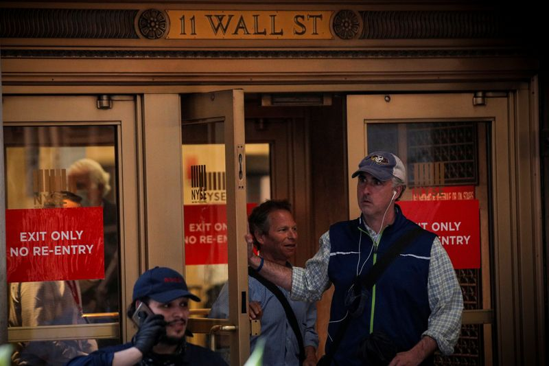 Wall Street ends higher with boost from technology stocks