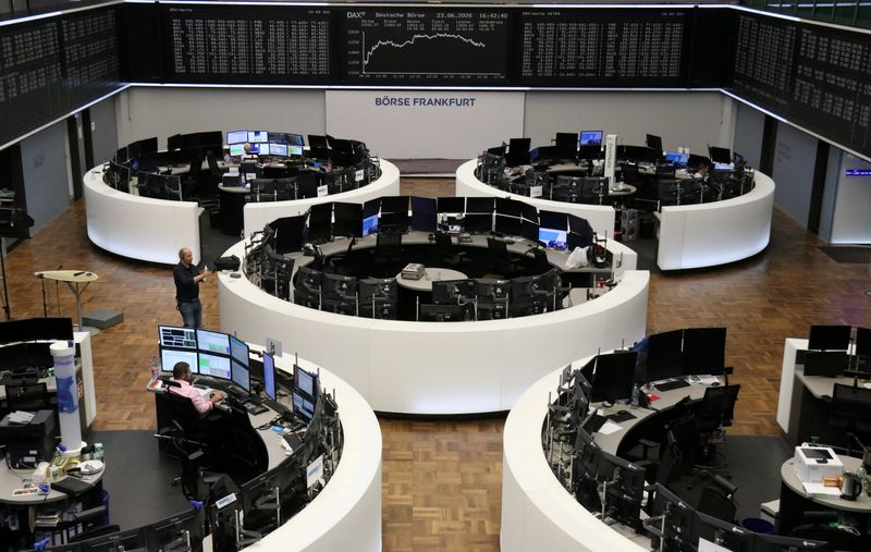 European stocks hit by losses in defensives; chipmakers rise