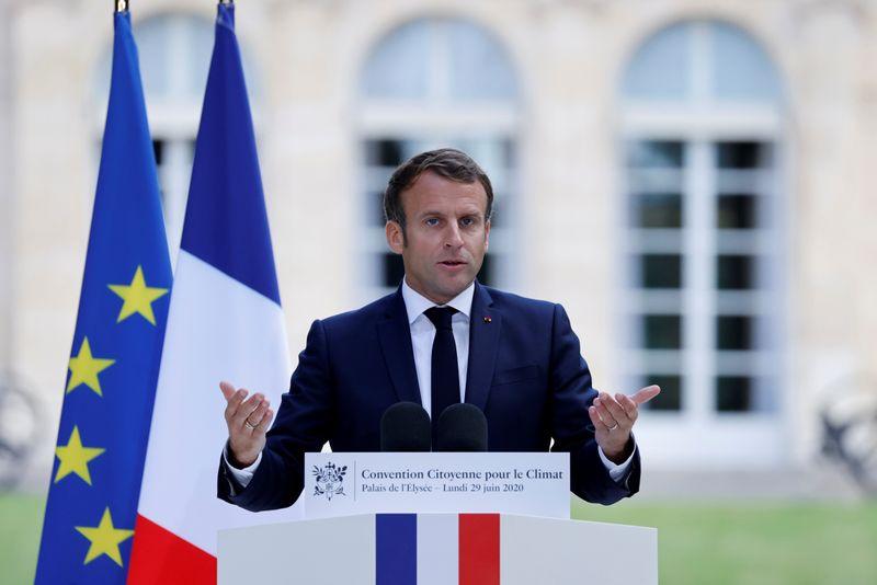 France's Macron pledges 15-billion-euro green push after vote rout
