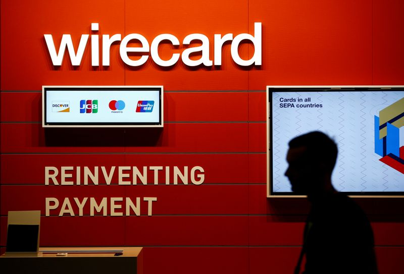 © Reuters. FILE PHOTO: A man walks past the Wirecard booth at the computer games fair Gamescom in Cologne, Germany