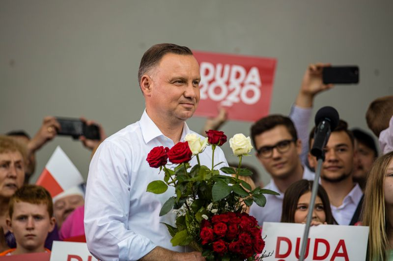 © Reuters. Polish President Andrzej Duda smiles during his election rally in Kwidzyn