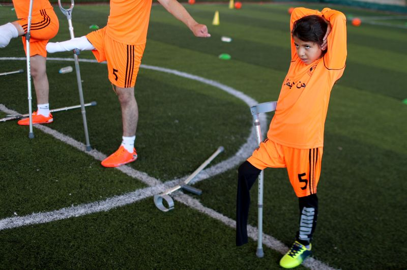 Young Gaza amputees play soccer again after coronavirus curbs eased
