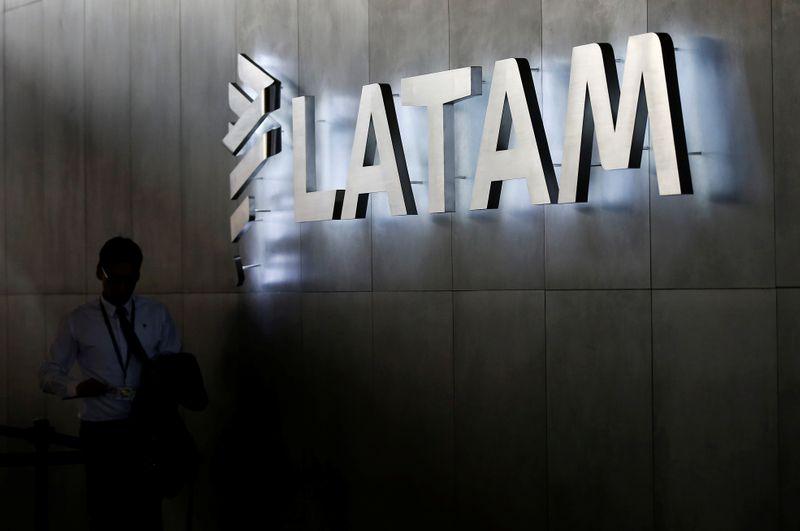 © Reuters. LATAM airlines logo, is seen inside of the Commodore Arturo Merino Benitez International Airport in Santiago