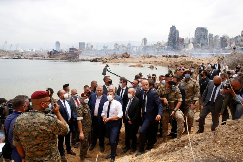 © Reuters. French President Emmanuel Macron visits the devastated site of the explosion at the port of Beirut