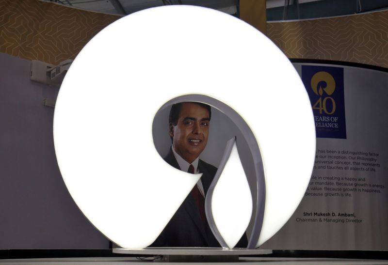 © Reuters. The logo of Reliance Industries is pictured in a stall at the Vibrant Gujarat Global Trade Show at Gandhinagar