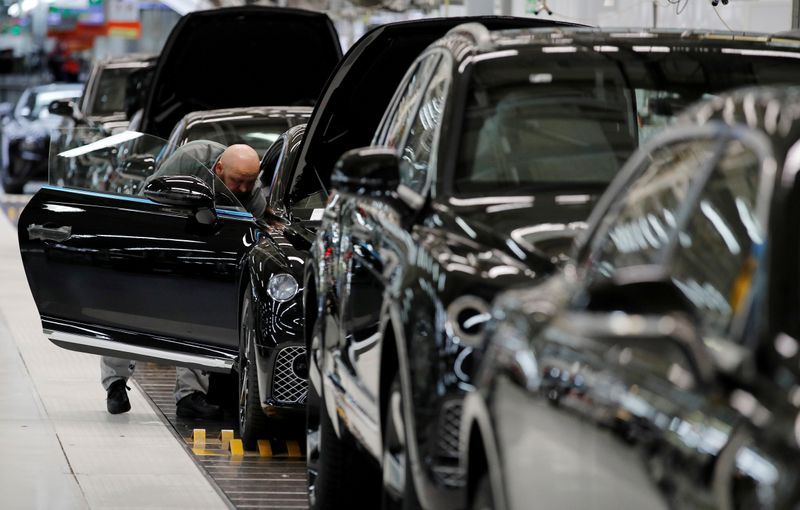 � Reuters. FILE PHOTO: Bentley cars go through final quality control as they come off the production line at their factory in Crewe