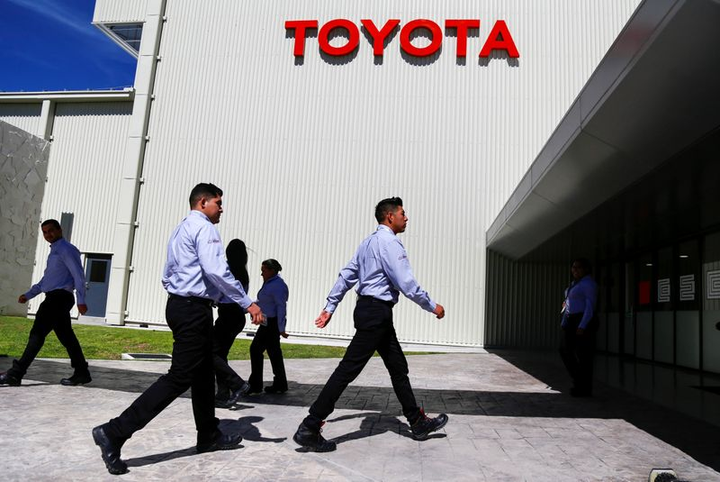 � Reuters. Employees walk at the Toyota Motor Corp new plant in Mexico's central state of Guanajuato