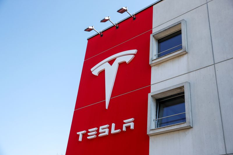 © Reuters. FILE PHOTO: Logo of Tesla is seen at a branch office in Bern