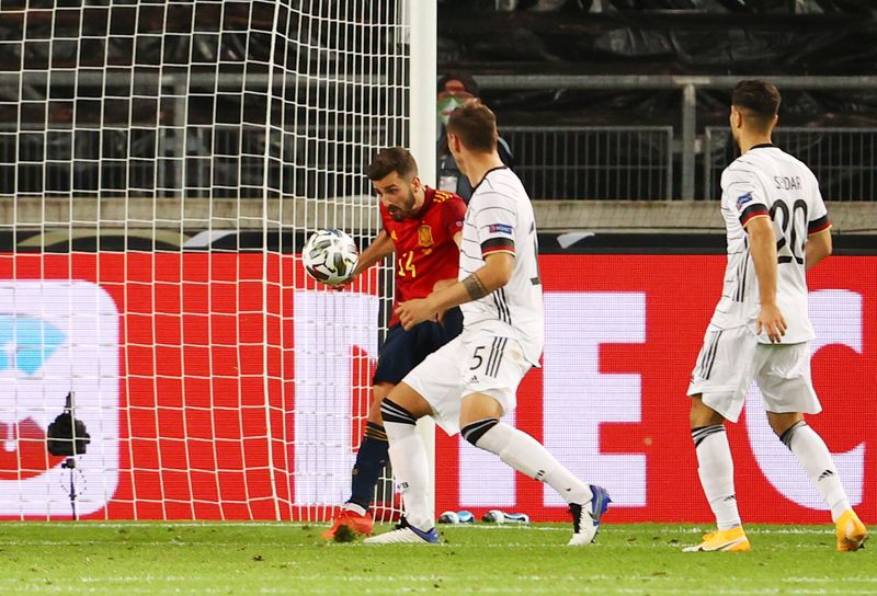 Spain Score Last Gasp Goal To Draw 1 1 With Germany By Reuters