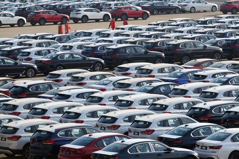 � Reuters. Newly manufactured cars are seen at a port in Dalian