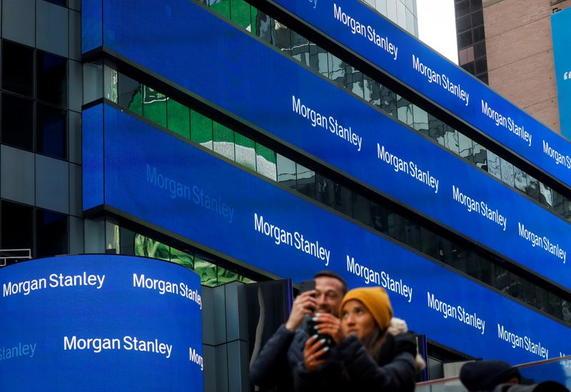 © Reuters. People take photos by the Morgan Stanley building in Times Square in New York