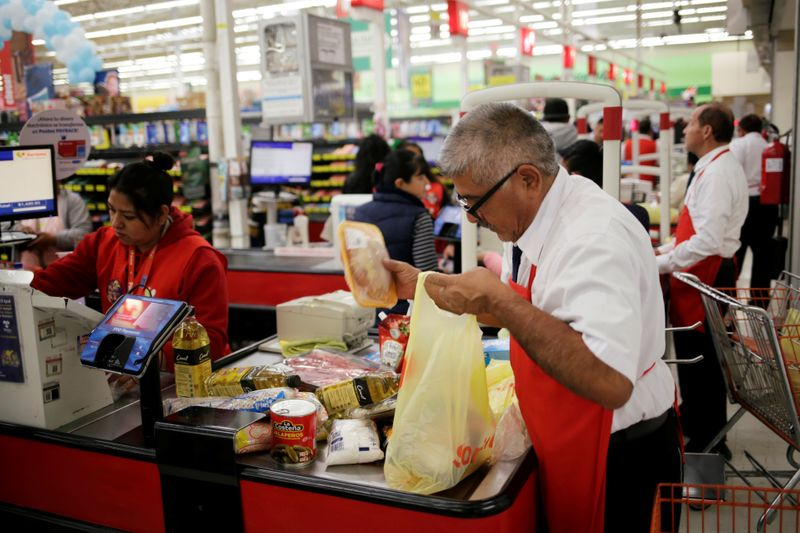 � Reuters. A man packs goods in a supermarket in Ciudad Juarez
