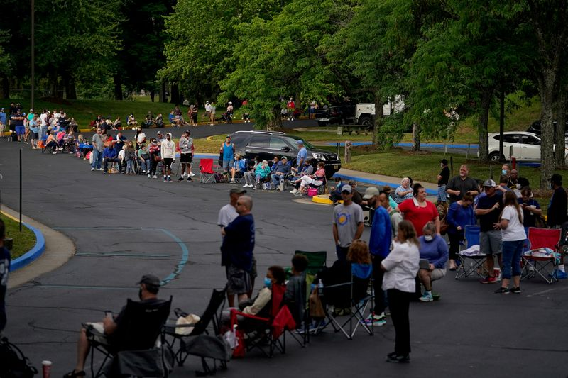 � Reuters. FILE PHOTO: People  wait outside Kentucky Career Center in Frankfort