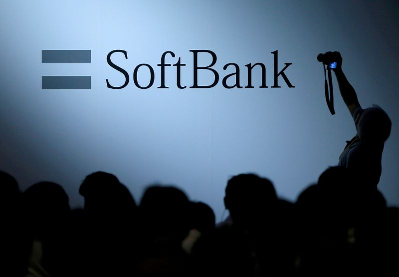 � Reuters. FILE PHOTO: The logo of SoftBank Group Corp is displayed at SoftBank World 2017 conference in Tokyo