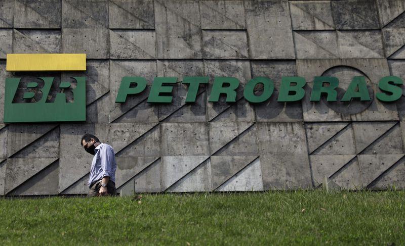 � Reuters. A man walks past the headquarters of Brazilian oil company Petrobras in Rio de Janeiro