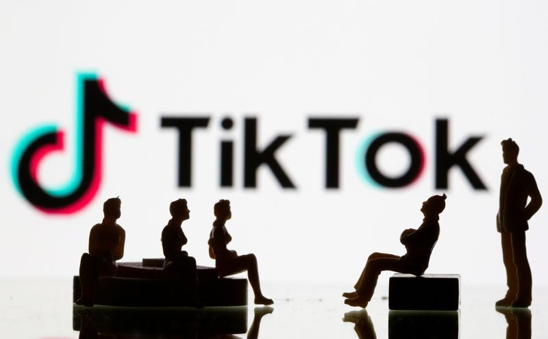 � Reuters. FILE PHOTO: Small toy figures are seen in front of a Tiktok logo in this illustration taken