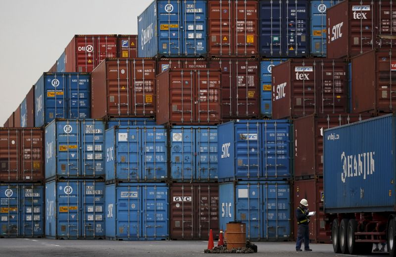 � Reuters. A laborer works in a container area at a port in Tokyo