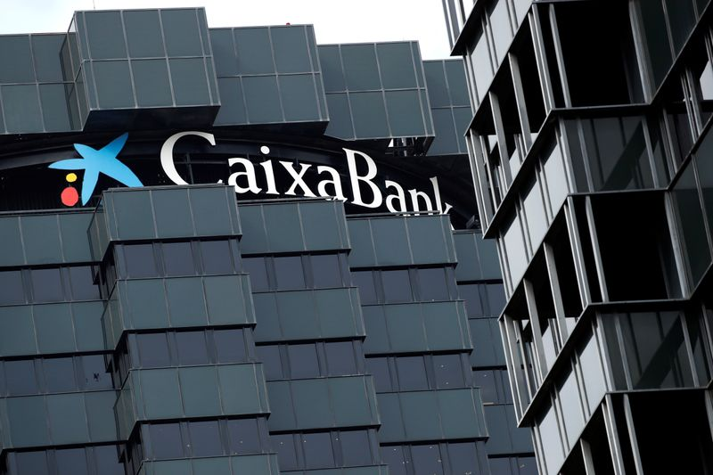© Reuters. CaixaBank's logo is seen on top of the company's headquarters in Barcelona