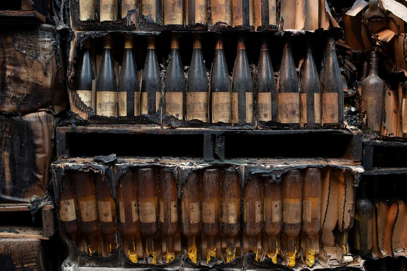 © Reuters. Wine bottles are seen destroyed at Castello di Amorosa winery after Glass Fire in Calistoga