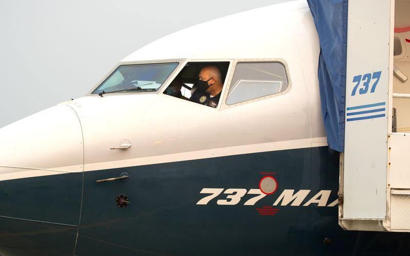 © Reuters. FILE PHOTO: FAA Chief Steve Dickson conducts a pre-flight check in a Boeing 737 MAX aircraft in Seattle