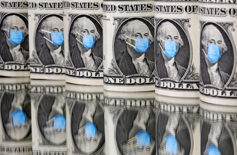 © Reuters. George Washington is seen with printed medical mask on the one Dollar banknotes in this illustration taken