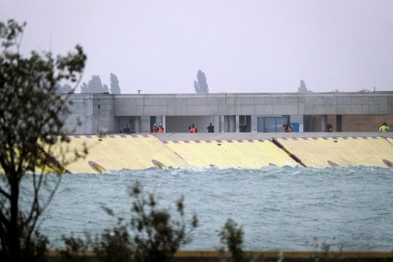 © Reuters. Mose flood barrier scheme is used for the first time, in Venice
