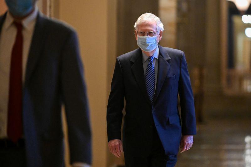 © Reuters. FILE PHOTO:  U.S. Senate Majority Leader McConnell walks through the U.S. Capitol building in Washington