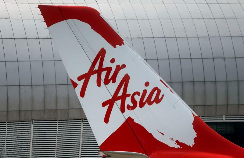 © Reuters. FILE PHOTO: Tail of AirAsia X plane as seen at the Garuda Maintenance Facility AeroAsia in Tangerang