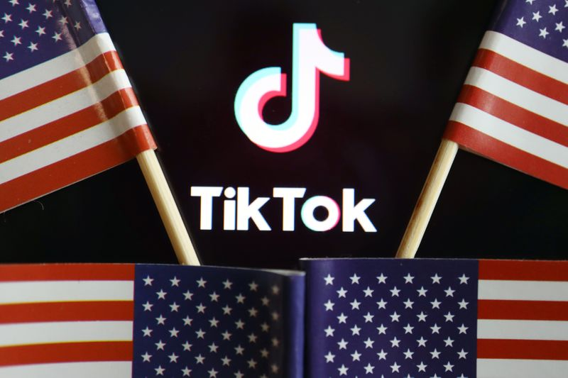 © Reuters. Illustration picture of Tiktok with U.S. flags