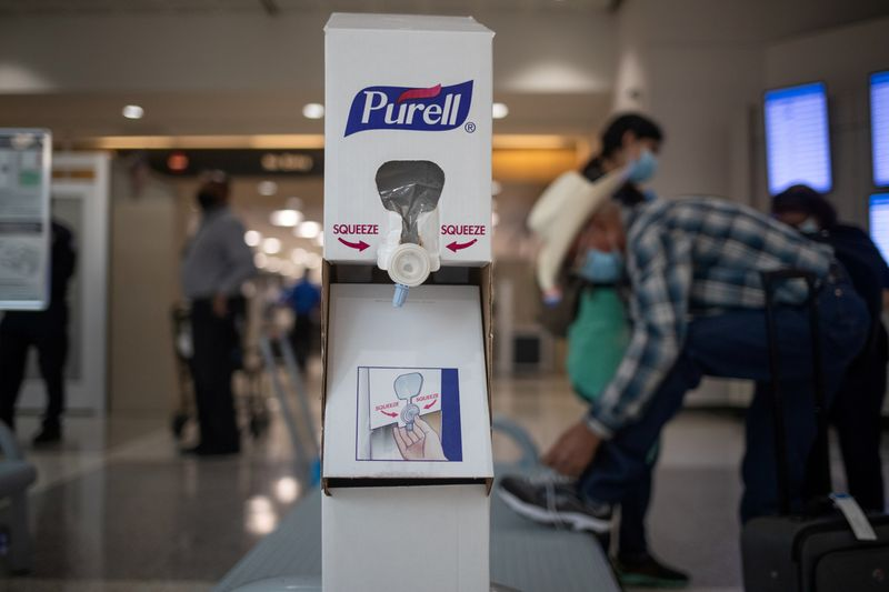 © Reuters. FILE PHOTO: Hand sanitizing station is seen after passengers pass a security check at IAH George Bush Intercontinental Airport in Houston