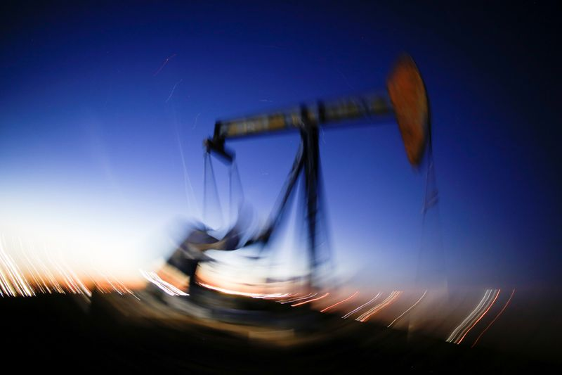© Reuters. A long exposure image shows the movement of a crude oil pump jack in the Permian Basin in Loving County