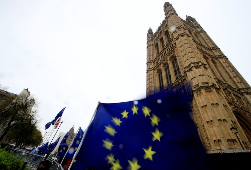 © Reuters. European Union flags are seen outside the Houses of Parliament in London