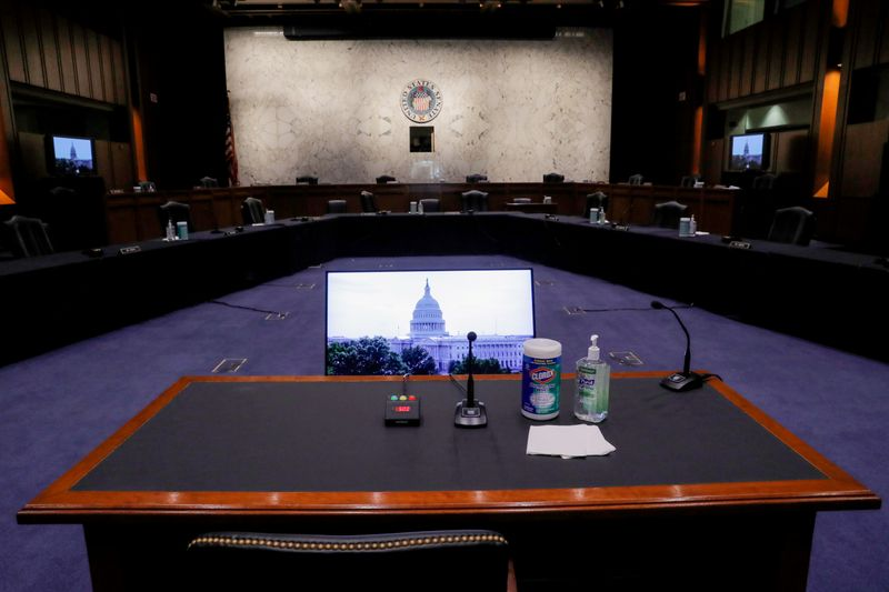 © Reuters. FILE PHOTO: The witness table sits ready for Supreme Court nominee Judge Amy Coney Barrett to begin her confirmation hearings in the U.S. Senate Judiciary Committee hearing room on Capitol Hill in Washington