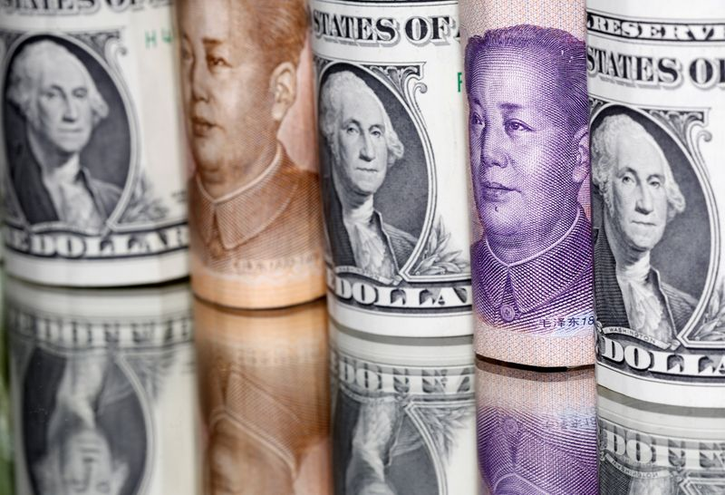 Dollar ticks up on stalled stimulus talk; yuan falls after PBOC move