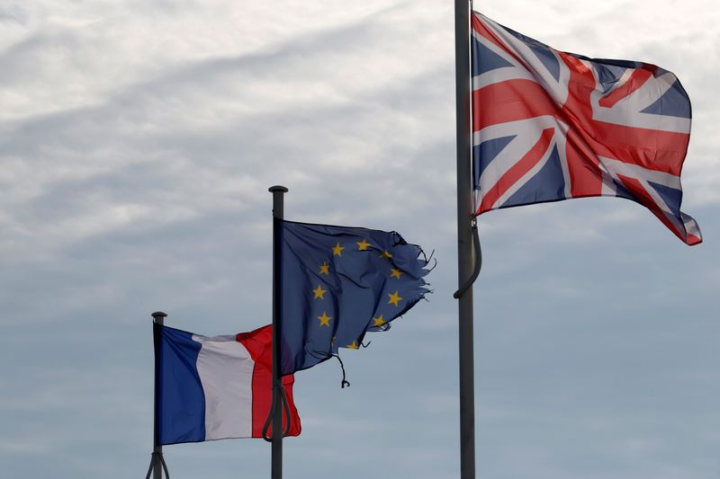 © Reuters. The French, British Union Jack and European flags are seen in the harbour of Calais