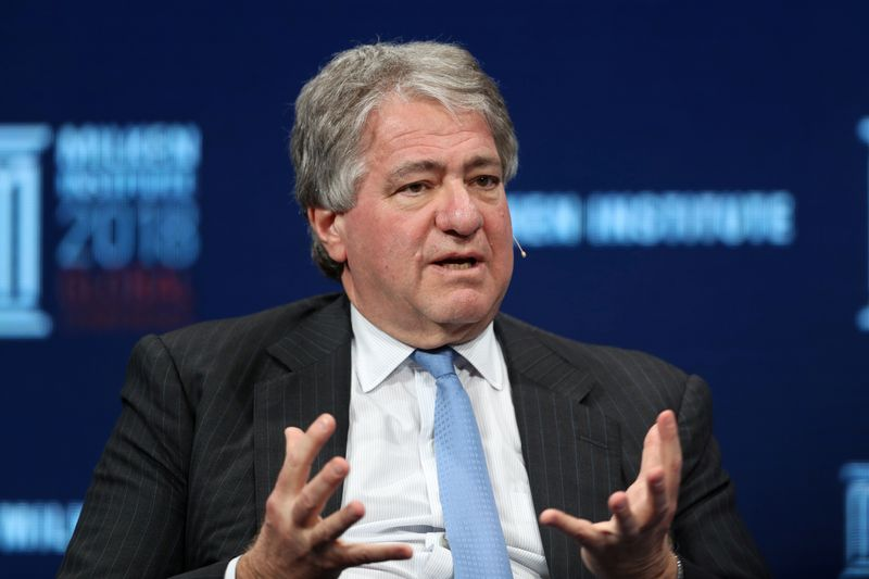 © Reuters. FILE PHOTO: Leon Black, Chairman, CEO and Director, Apollo Global Management, LLC, speaks at the Milken Institute's 21st Global Conference in Beverly Hills
