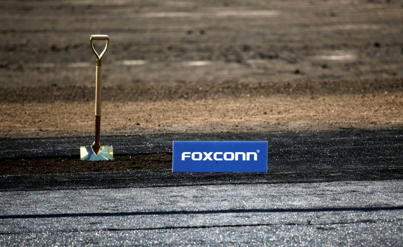 © Reuters. Shovel and FoxConn logo are seen before the arrival of U.S. President Donald Trump for the Foxconn Technology Group groundbreaking ceremony in Mount Pleasant