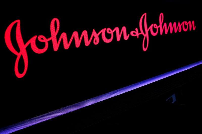 © Reuters. FILE PHOTO: The Johnson & Johnson logo is displayed on a screen on the floor of the NYSE in New York